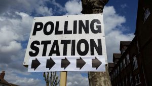 Sign post to a polling station
